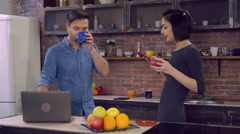 Male and girl enjoy warm drink in apartment Stock Footage