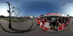 360Vr Video Kites Festival Leba People Riding Small Tour Bus by Road Amusement Stock Footage