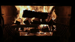 Fireplace burning. Warm cozy burning fire in a brick fireplace close up. Stock Footage