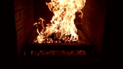 Burning fire in a brick fireplace Stock Footage