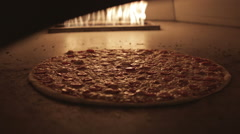 Pizza Cooking in a Pizza Oven Stock Footage