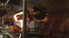Rotisserie Chicken Cooking Over Flames Stock Footage