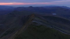 Tilting aerial reveal of the summit of Snowdon. Stock Footage
