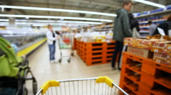 Moving shopping cart in a large supermarket Stock Footage