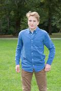 Teenager boy, in the park walking on the grass Stock Photos