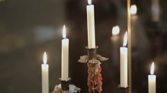 Chandelier burning on elegant, romantic decorated table in restaurant. Stock Footage