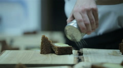 Chef prepares a dessert in a restaurant kitchen. Close up, dish presentation Stock Footage