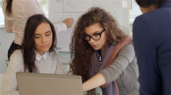 Creative team of four women work actively at the office Stock Footage