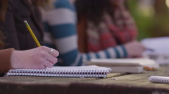 Closeup of college student taking notes Stock Footage