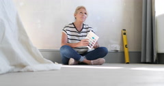 Mature female looking at colour card Stock Footage