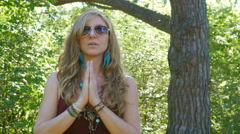 Peaceful hippie. Young groovy woman. Hands held in prayer position. Stock Footage