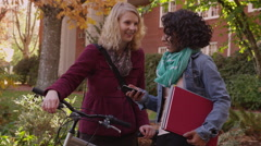 Two college students on campus looking at cell phone Stock Footage