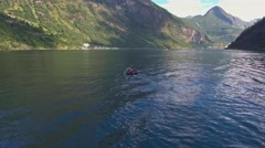 Couple on motor boat sailing on Geirangerfjord, Norway Stock Footage