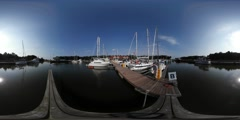 360Vr Video Man on Wooden Pier Yachts Leisure Boats Are Moored at Piers at the Stock Footage