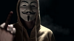 Anonymous hacker activist on black background Stock Footage
