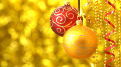 Red and golden Christmas balls swinging. New Year decoration. Blurred Golden Stock Footage
