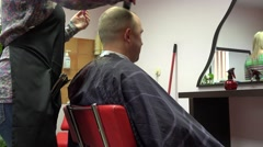 Hairdresser woman cut male client in beauty salon barber. 4K Stock Footage