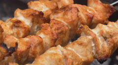 Meat on grill. Cooking shish kebab on skewers Stock Footage