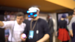 Low focused.Young manin Virtual Reality Glasses. VR. Belarussian comic con. Stock Footage