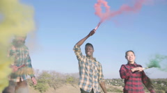 Dancing colored smoke grenades Stock Footage