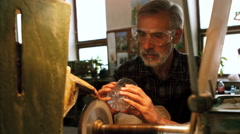 Glassblower working on a glass Stock Footage