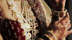 Indian bride touches rich bracelets on her wirst Stock Footage