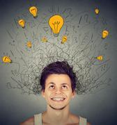 Man with light bulbs over his head Stock Photos
