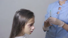 Little girl is afraid of the doctor with a syringe. baby cries afraid injection Arkistovideo