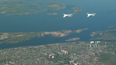 Two of the aircraft flying over the river Stock Footage