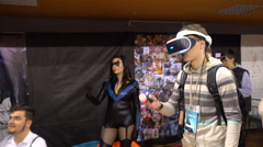 Young manin Virtual Reality Glasses. VR. Belarussian comic con. Minsk. 2016. Stock Footage