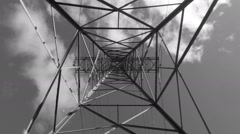 Underneath a hydro-electric tower. Black and white. Time lapse clouds. Stock Footage