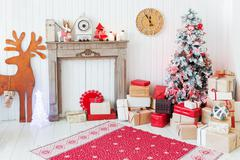 Christmas and New Year details of home interior - wooden deer, mantelpiece wi Stock Photos