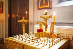 Golden candleholder in Orthodox church. Symbolic Orthodox gold cross with the Stock Photos