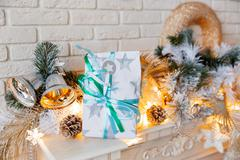 Christmas and New Year decorations on mantelpiece. Holiday winter background  Stock Photos