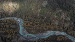 Glacial Blue River Snaking Magic Mountain Forest Aerial Stock Footage