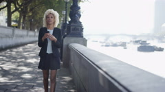 4K London professional woman texting on phone as she walks through city Stock Footage
