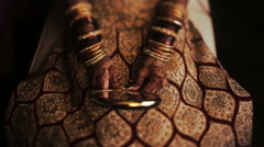 Hands with golden bracelets hold mirror on the knees Stock Footage