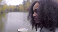 Cute black girl wrapping herself in woolen plaid and drinking hot tea Stock Footage