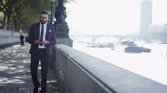 4K London professional man texting on phone as he walks through city Stock Footage