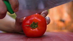Chef cutting tomato slice Stock Footage