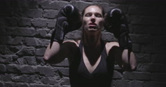 FEMALE BOXER WORKING OUT. Slow motion Medium Close Up Shot. A boxing woman Arkistovideo