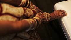 Mehndi covers delicate Indian bride's hands full of bracelets Stock Footage