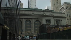 Grand Central Terminal with commuters, skyscrapers in Manhattan New York City Stock Footage