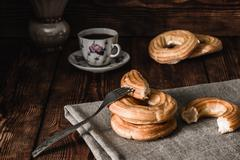 Coffee Break with Eclairs Stock Photos