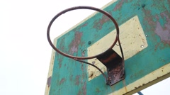 Old basketball hoop sport outdoors rusty iron ball enters the basket Stock Footage