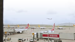 An Airplane taking off. Planes waiting on track in the foreground  Stock Footage