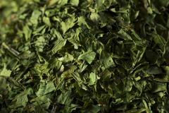 Dry Organic Green Parsley Flakes Stock Photos