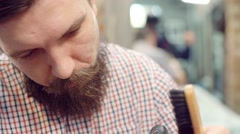 The Barber with the beard makes the cut men, the head and beard Barbershop Stock Footage