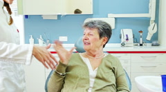 Friendly elderly woman with toothache at dentist Stock Footage
