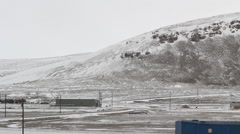 Snowy hills with roads in front of them. Stock Footage